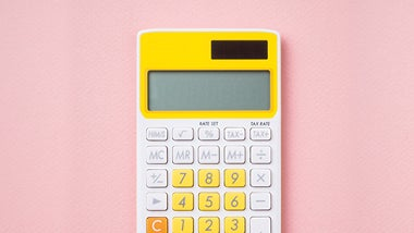 Yellow and white calculator against pink calculator