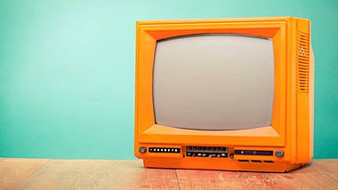Orange TV against green background